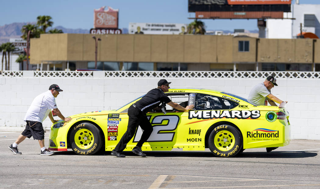 Rayn Blaney's No. 12 Team Penske Ford is moved into postition in preparation for the 2018 NASCAR Burnout Blvd to introduce the NASCAR South Point 400 Weekend as cars are staged in the Las Vegas Co ...