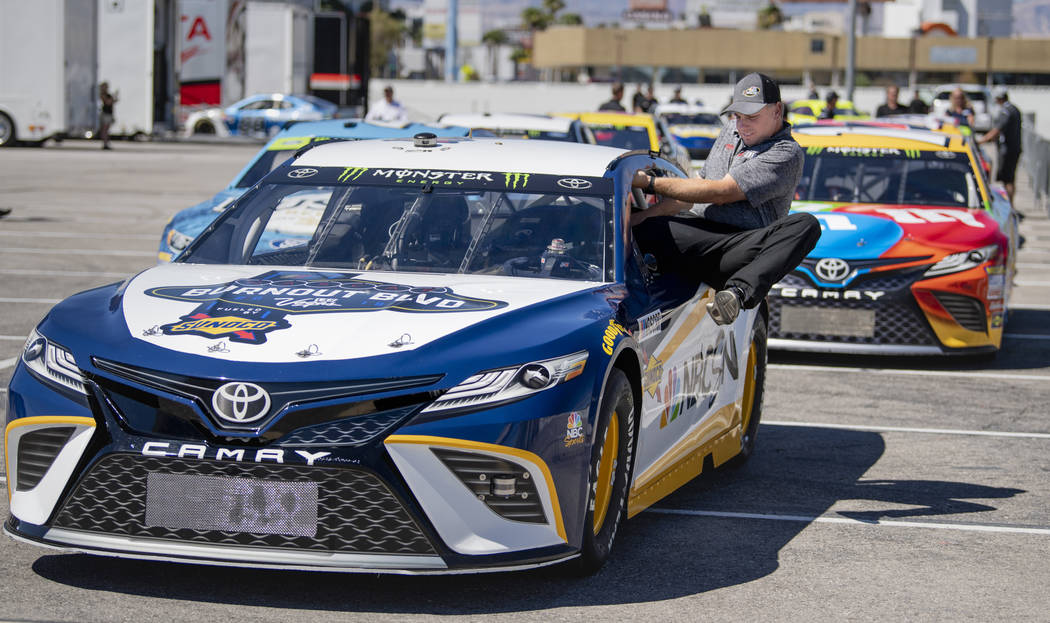 Louie Ellis of Gaunt Racing climbs into the NBCSN lead car in preparation for the 2018 NASCAR Burnout Blvd to introduce the NASCAR South Point 400 Weekend as cars are staged in the Las Vegas Conve ...