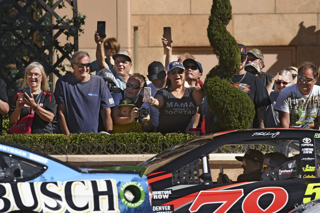Fans cheer for NASCAR drivers during the 2018 NASCAR Burnout Blvd event on the Las Vegas Strip at Spring Mountain Road Thursday, September 13, 2018. The event kicks off the Fall NASCAR Weekend at ...