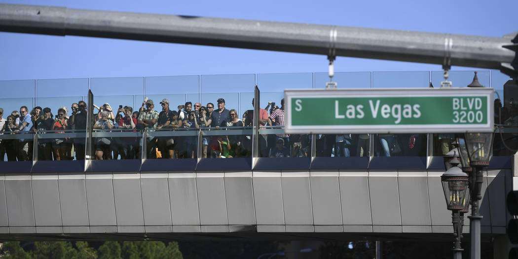 Fans line a pedestrian overpass to watch the action during the 2018 NASCAR Burnout Blvd event on the Las Vegas Strip at Spring Mountain Road Thursday, September 13, 2018. The event kicks off the F ...
