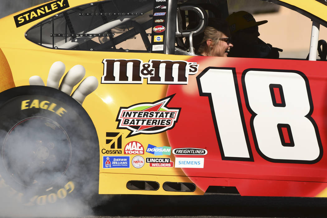 A passenger laughs while riding in Kyle Busch's car during the 2018 NASCAR Burnout Blvd event on the Las Vegas Strip at Spring Mountain Road Thursday, September 13, 2018. The event kicks off the F ...