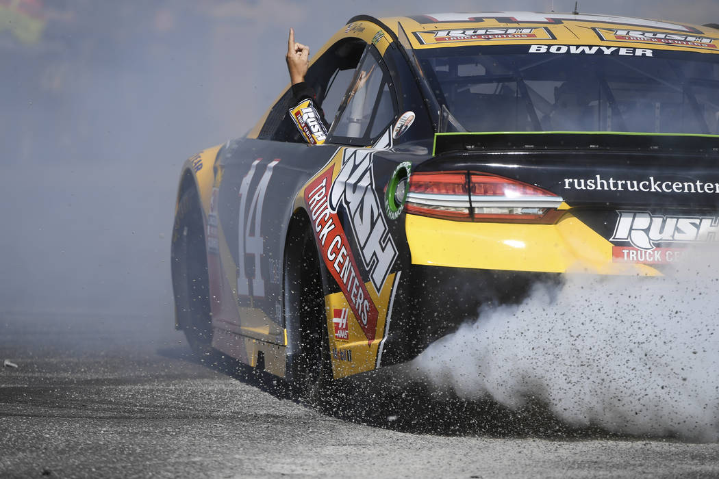 Clint Bowyer (14) points to the sky while doing donuts during the 2018 NASCAR Burnout Blvd event on the Las Vegas Strip at Spring Mountain Road Thursday, September 13, 2018. The event kicks off th ...