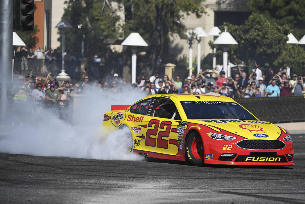 Joey Logano creates a plume of smoke during the 2018 NASCAR Burnout Blvd event on the Las Vegas Strip at Spring Mountain Road Thursday, September 13, 2018. The event kicks off the Fall NASCAR Week ...