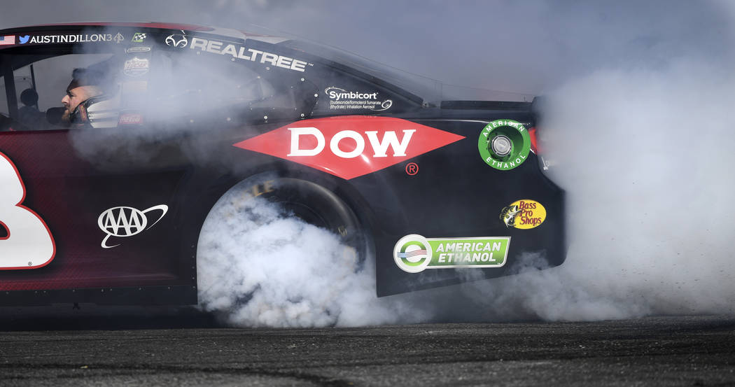 Austin Dillon (3) lays down a plume of smoke during the 2018 NASCAR Burnout Blvd event on the Las Vegas Strip at Spring Mountain Road Thursday, September 13, 2018. The event kicks off the Fall NAS ...