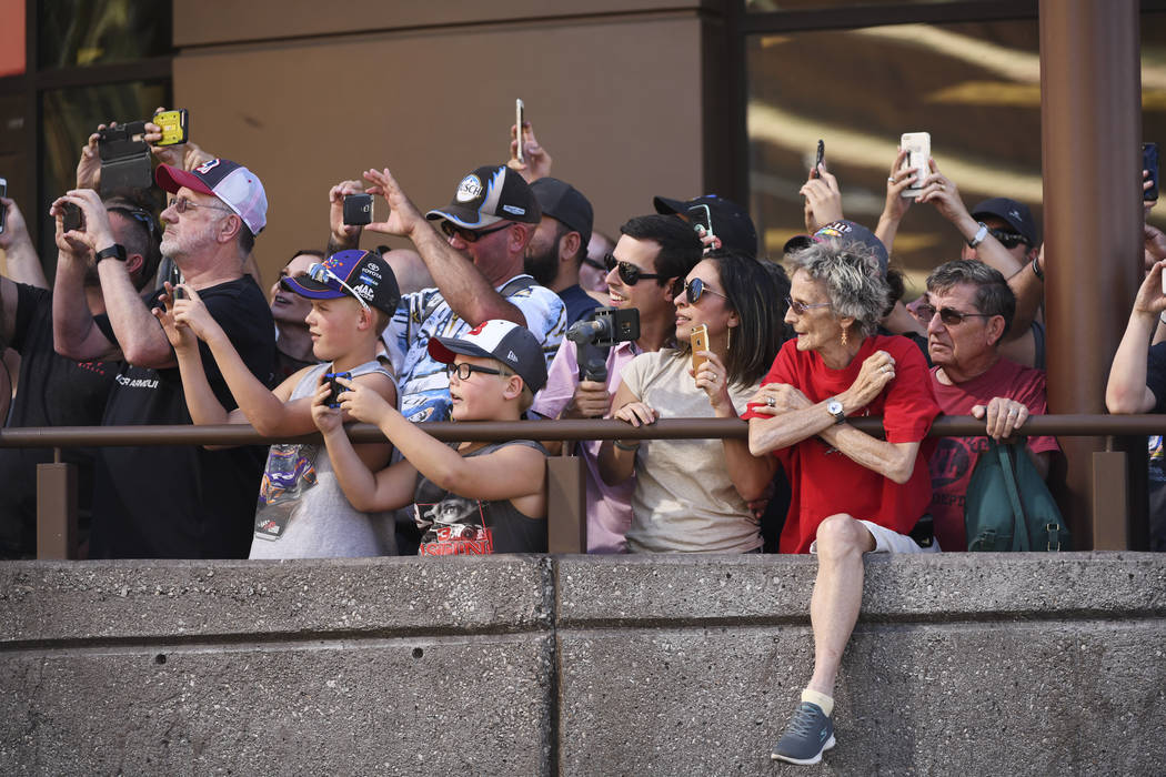 Fans watch NASCAR drivers smoke their tires during the 2018 NASCAR Burnout Blvd event on the Las Vegas Strip at Spring Mountain Road Thursday, September 13, 2018. The event kicks off the Fall NASC ...