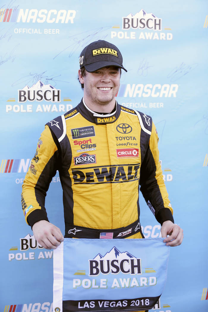 Erik Jones poses for photos after qualifying for a NASCAR Cup Series auto race at Las Vegas Motor Speedway Friday, Sept. 14, 2018, in Las Vegas. Jones won the pole position. (AP Photo/Isaac Brekken)