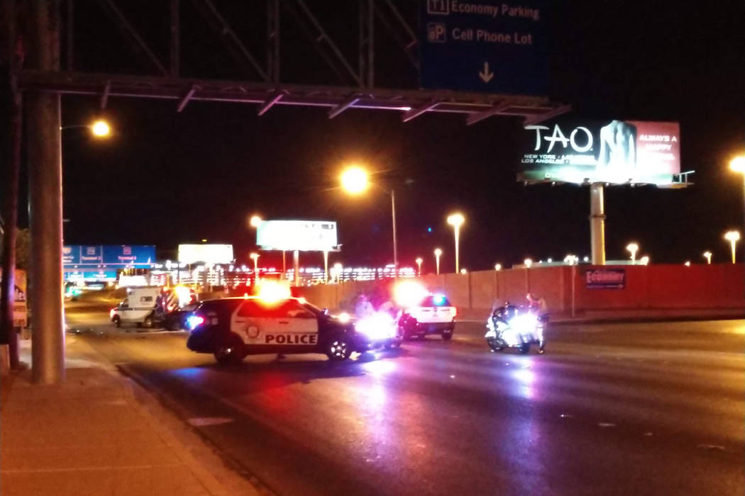 Police block off Paradise Road just north of the Airport Connector while they investigate an early Friday morning injury crash. (Max Michor/Las Vegas Review-Journal)