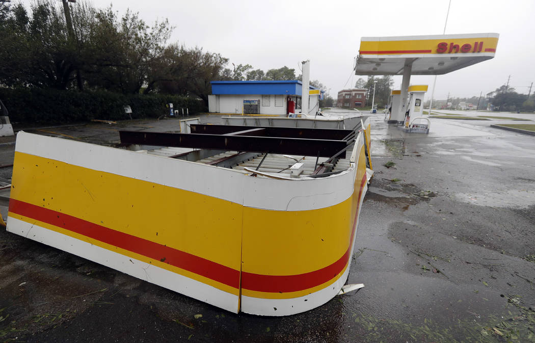 The shelter of a gas station lies on the ground in Wilmington, N.C., after Hurricane Florence made landfall Friday, Sept. 14, 2018. (AP Photo/Chuck Burton)