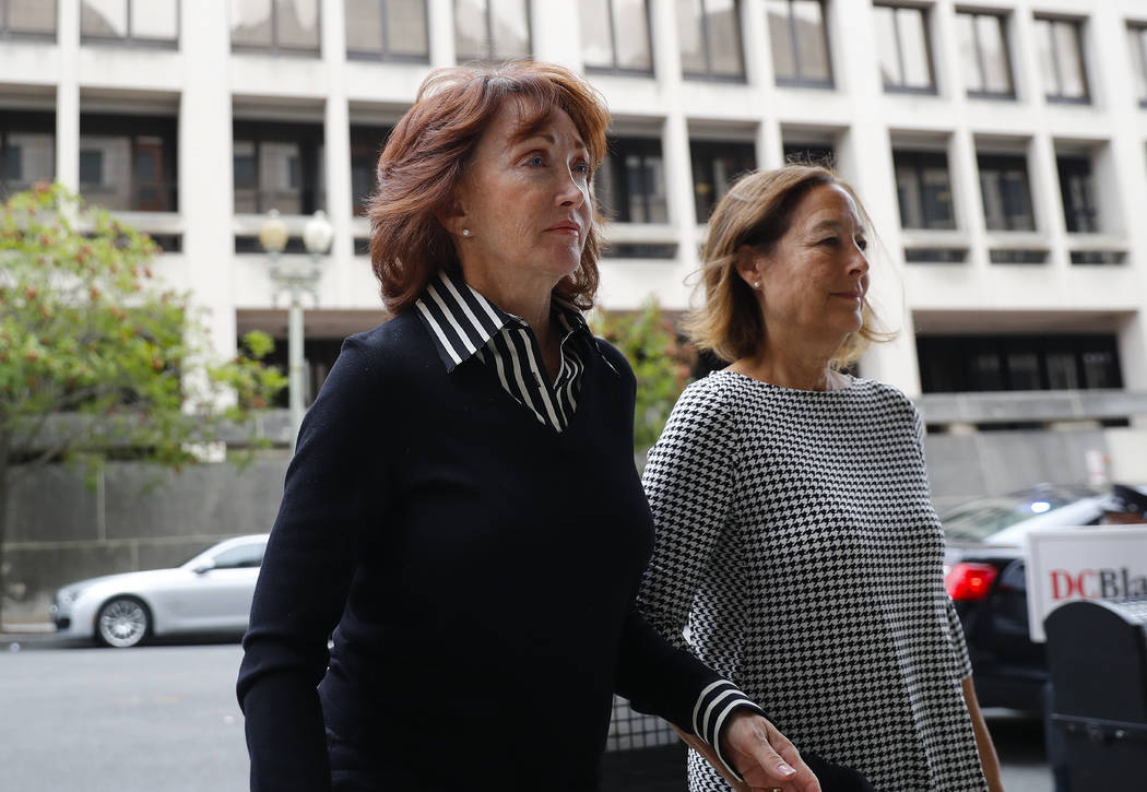 Paul Manafort's wife, Kathleen Manafort, left, arrives at federal court in Washington, Friday, Sept. 14, 2018. Former Trump campaign chairman Paul Manafort is expected to plead guilty to federal c ...