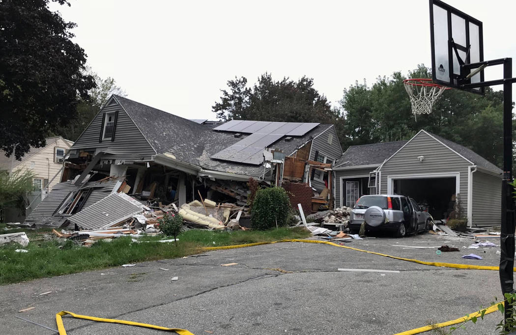 A house is destroyed in Lawrence, Mass., Thursday, Sept. 13, 2018 after a series of gas explosions in the area. First-responders continued to fight at least 50 fires in Lawrence, Andover and North ...