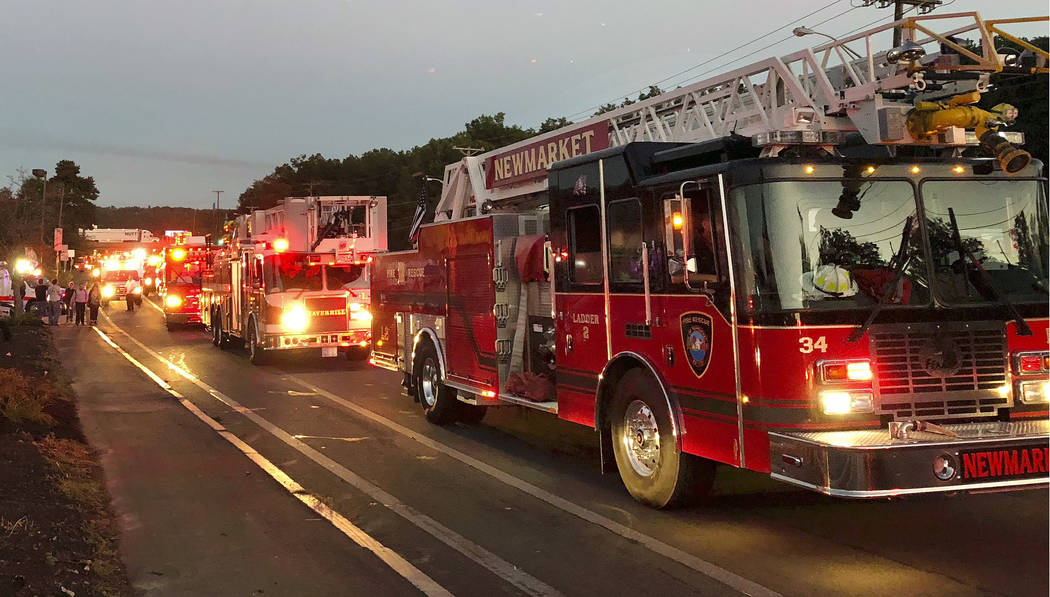 Multiple fire trucks from surrounding communities arrive Thursday, Sept. 13, 2018, in Lawrence, Mass., responding to a series of gas explosions and fires triggered by a problem with a gas line tha ...