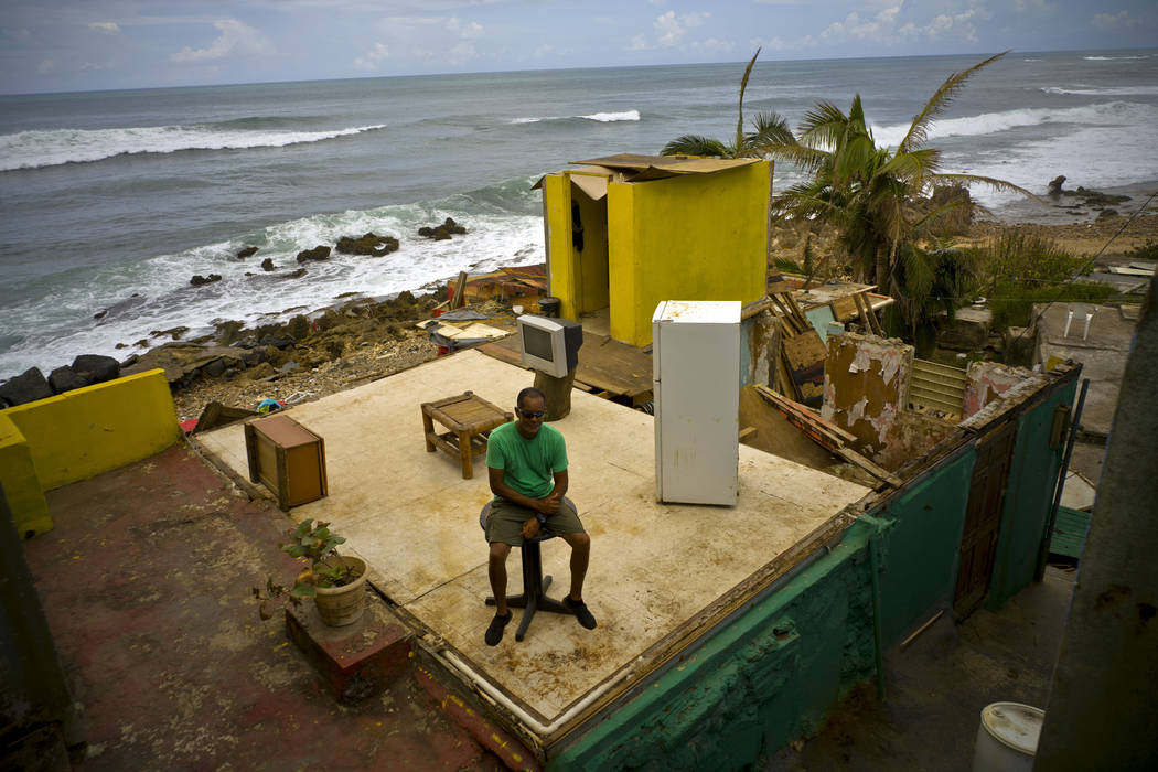 Roberto Figueroa Caballero sits in his home destroyed by Hurricane Maria, two weeks after the storm hit La Perla neighborhood on the coast of San Juan, Puerto Rico, Oct. 5, 2017. Figueroa, who wan ...