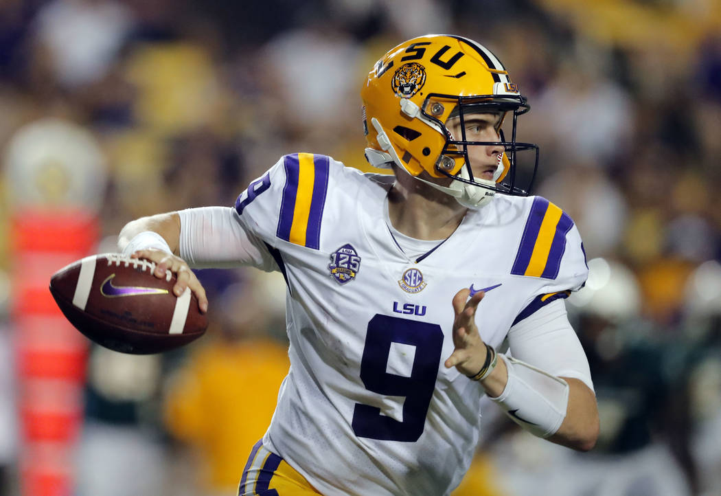 FILE - In this Sept. 8, 2018 file photo LSU quarterback Joe Burrow (9) scrambles as he looks for a receiver in the second half of an NCAA college football game against Southeastern Louisiana in Ba ...