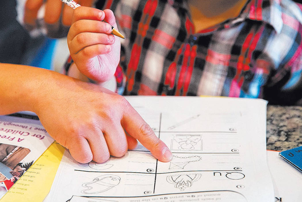 A student gets help with his homework. (Las Vegas Review-Journal)