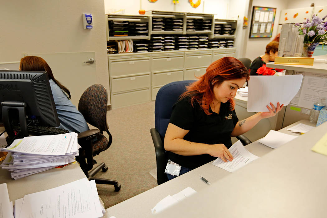 Family Law Self-Help Center staff member Cynthia Hardin, center, works at the center in Las Vegas, Friday, Sept. 14, 2018. Chitose Suzuki Las Vegas Review-Journal @chitosephoto