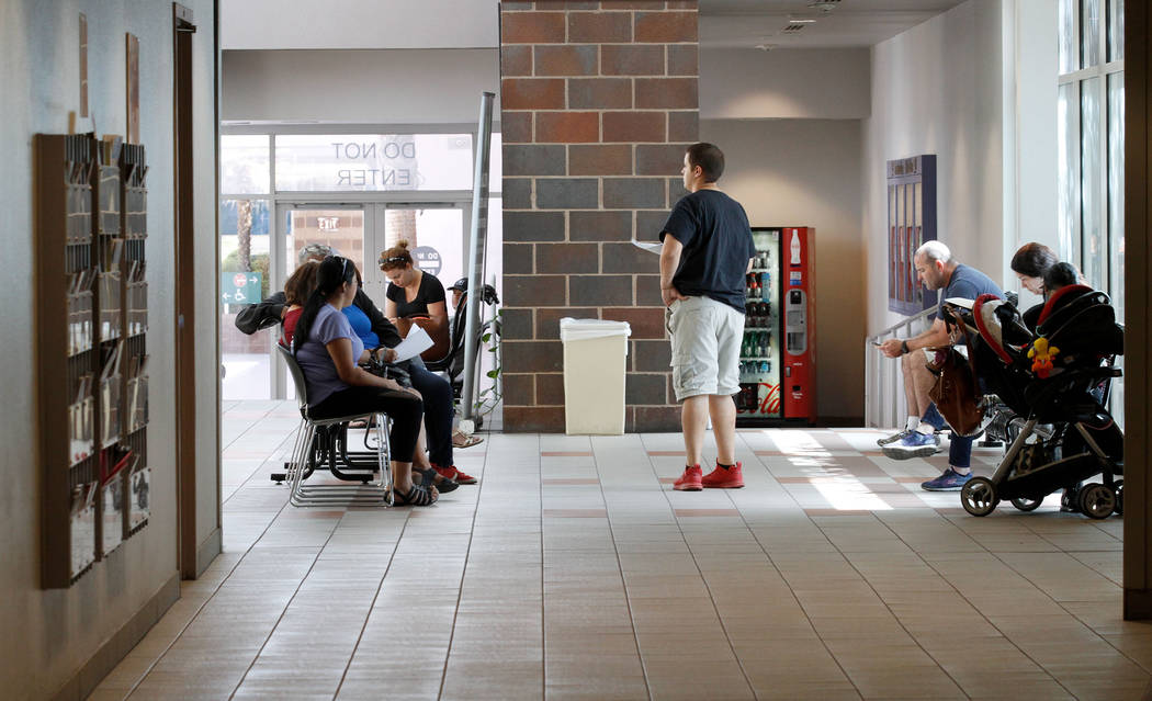 People wait in the waiting room at Family Court in Las Vegas, Friday, Sept. 14, 2018. Chitose Suzuki Las Vegas Review-Journal @chitosephoto