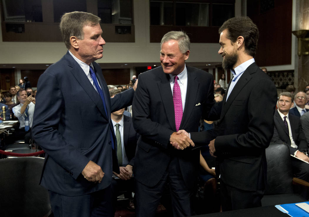 Senate Intelligence Committee Vice Chairman Mark Warner, D-Va., left, and Chairman Sen. Richard Burr, R-N.C., center, greet Twitter CEO Jack Dorsey before he testifies before the Senate Intelligen ...