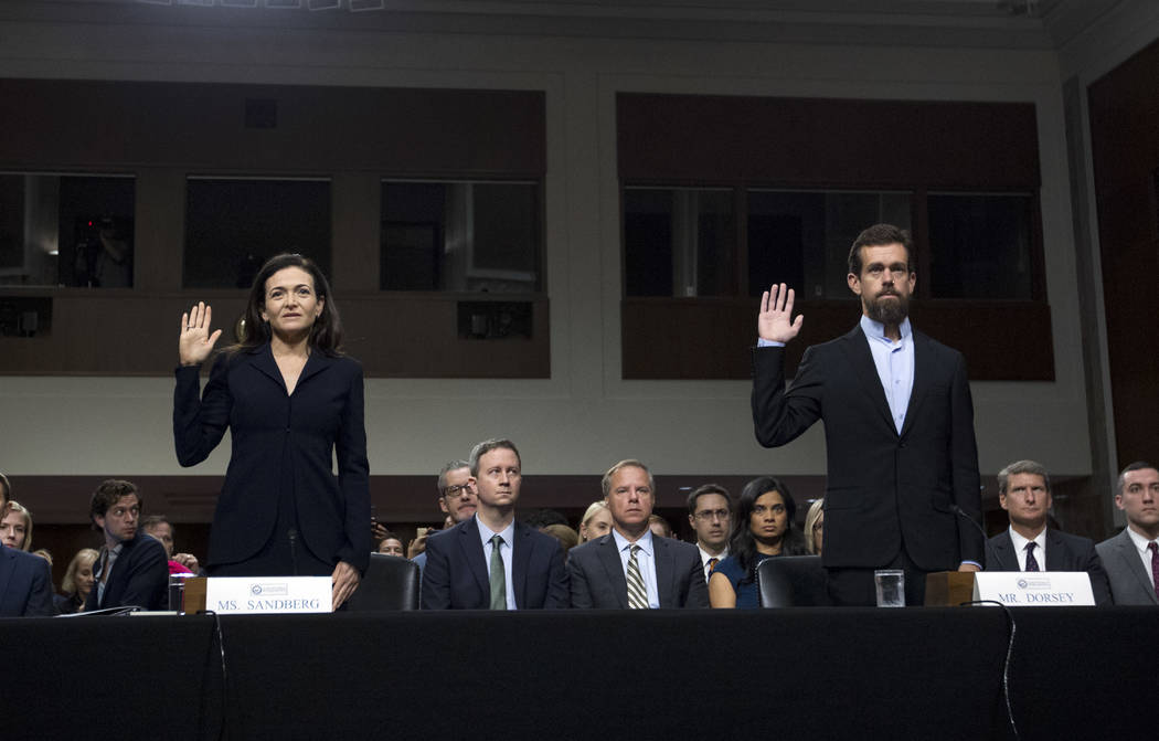 Facebook COO Sheryl Sandberg, left, accompanied by Twitter CEO Jack Dorsey are sworn in before the Senate Intelligence Committee hearing on 'Foreign Influence Operations and Their Use of Social Me ...