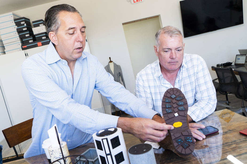 Ross & Snow co-founders Fred Mossler, left, and Steve Hill talk about their product in an interview at the footwear company's headquarters in downtown Las Vegas, Monday, Sept. 10, 2018. (Marcu ...
