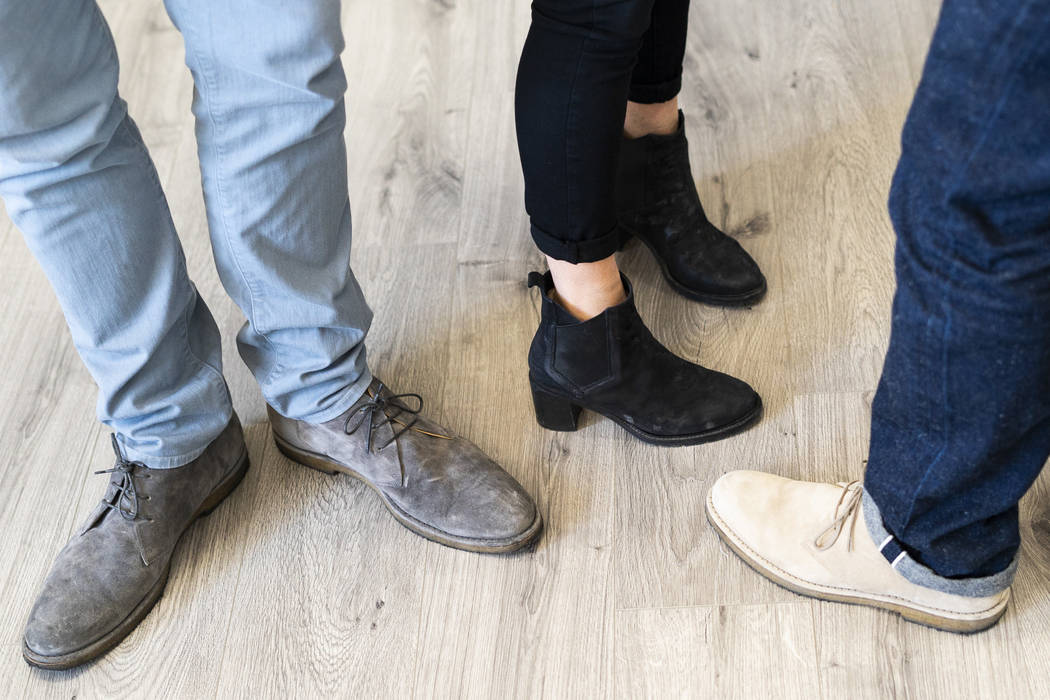 From left, Ross & Snow co-founders Fred Mossler, Meghan Mossler and Steve Hill photographed wearing the company's shoes at their headquarters in downtown Las Vegas, Monday, Sept. 10, 2018. (Ma ...