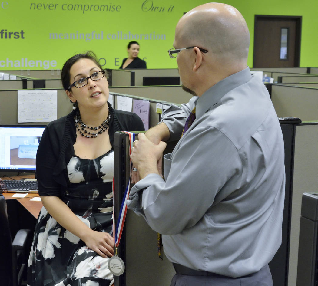 Aimee Riley talks with James Stover at MassMedia offices in this 2013 file photo. (Bill Hughes/Las Vegas Review-Journal)