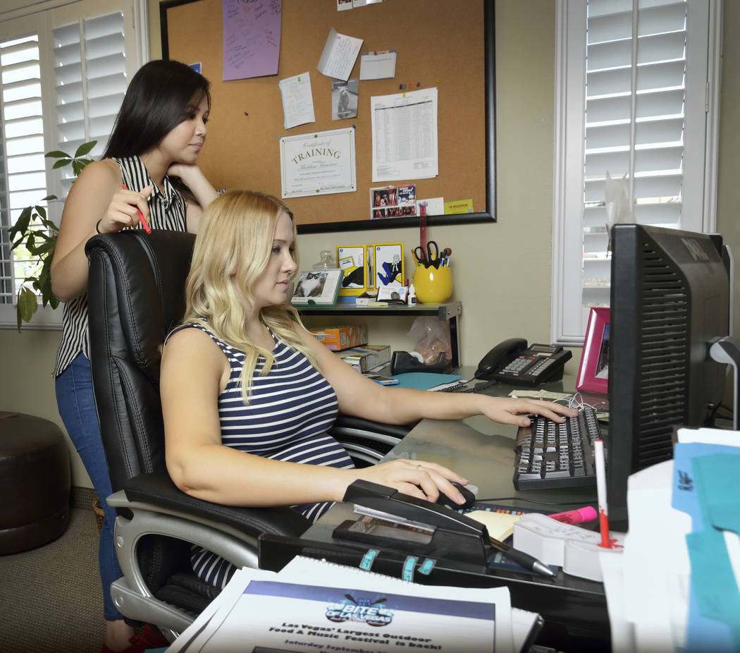 Hannah Dela Cruz and Madeline Tremaine review sponsorship opportunities at MassMedia offices in this 2013 file photo. (Bill Hughes/Las Vegas Review-Journal)