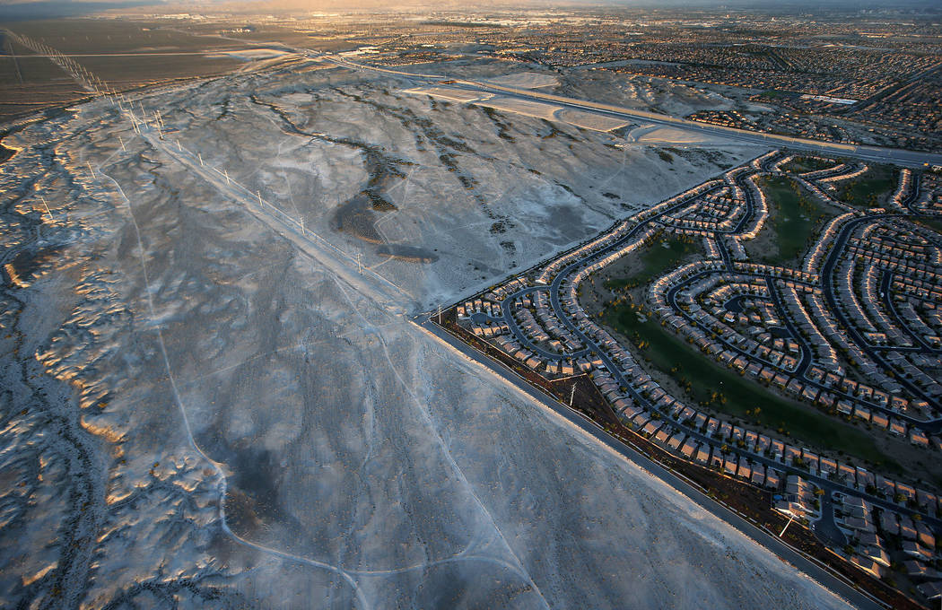 In this June 16, 2016, photo, a housing tract abuts the desert in Las Vegas. In Las Vegas, half-finished housing developments, relics of the housing boom, pockmark the surrounding desert. (AP Phot ...