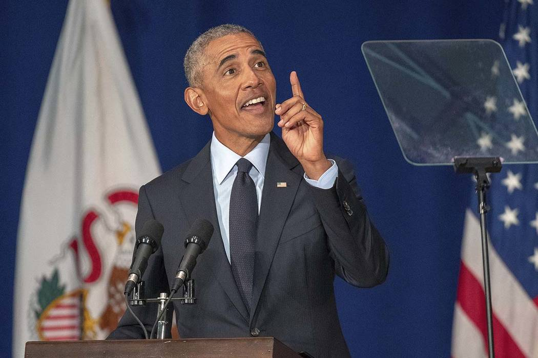 Former President Barack Obama speaks in Foellinger Auditorium on the University of Illinois campus in Urbana, Ill., on Friday, Sept. 7, 2018. Obama will receive a medal for the Paul H. Douglas Awa ...