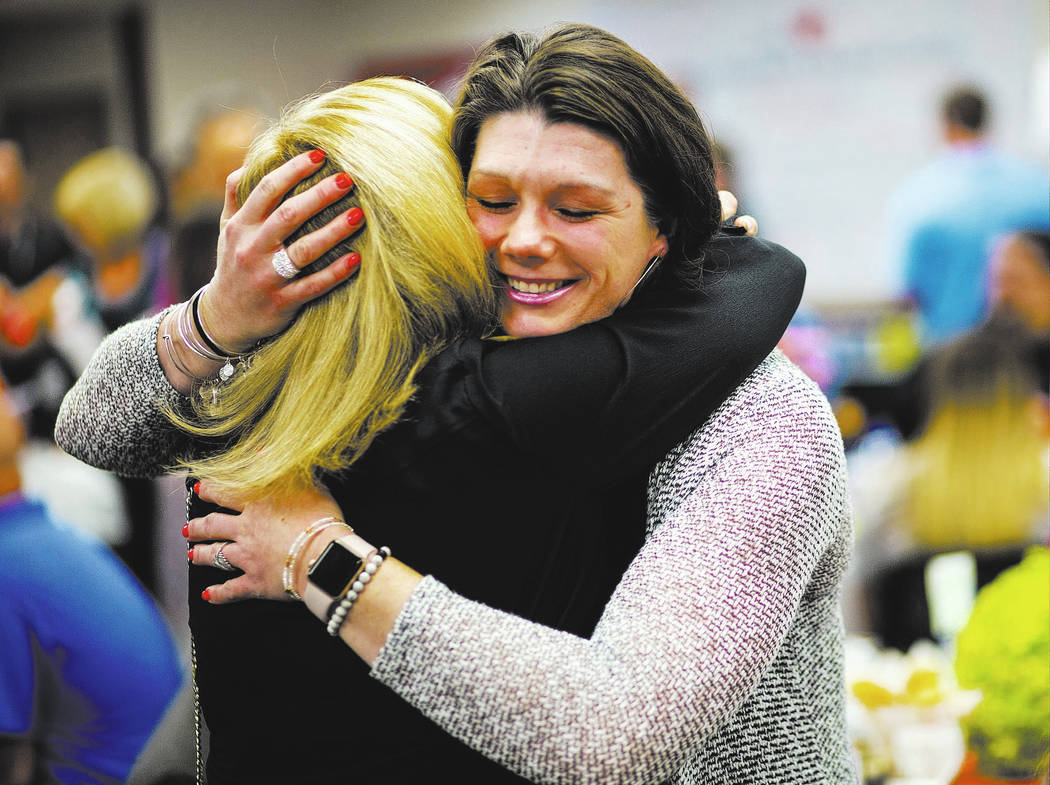 Oct. 1 survivor Amanda Peterson of Riverside, Calif., right, embraces nurse Marlena Ryan during an event honoring the survivors of the Route 91 festival shooting and the caregivers and physicians ...