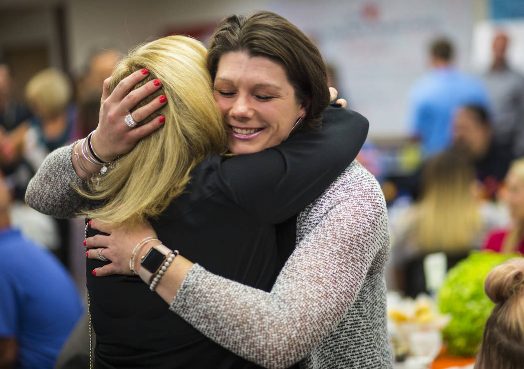 Oct. 1 survivor Amanda Peterson of Riverside, Calif., right, embraces nurse Marlena Ryan at Sunrise Hospital and Medical Center in Las Vegas on Friday, Sept. 14, 2018. (Chase Stevens Las Vegas Re ...