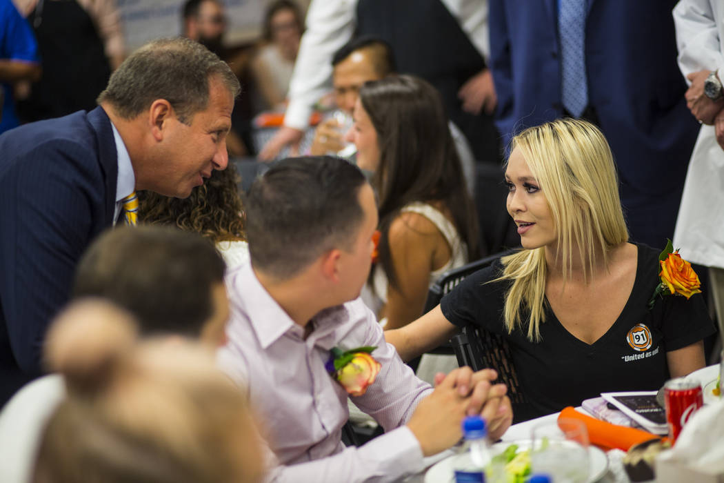 Sunrise Hospital CEO Todd Sklamberg, left, greets Oct. 1 survivors Summer Clyburn, right, and fiance Michael Gracia, at the hospital in Las Vegas on Friday, Sept. 14, 2018. Clyburn was shot in the ...