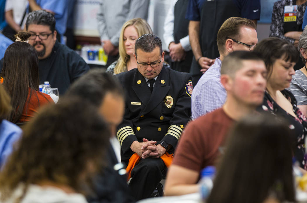 Las Vegas Fire & Rescue Medical Director David Slattery sits in prayer at Sunrise Hospital and Medical Center in Las Vegas on Friday, Sept. 14, 2018. (Chase Stevens Las Vegas Review-Journal @csste ...