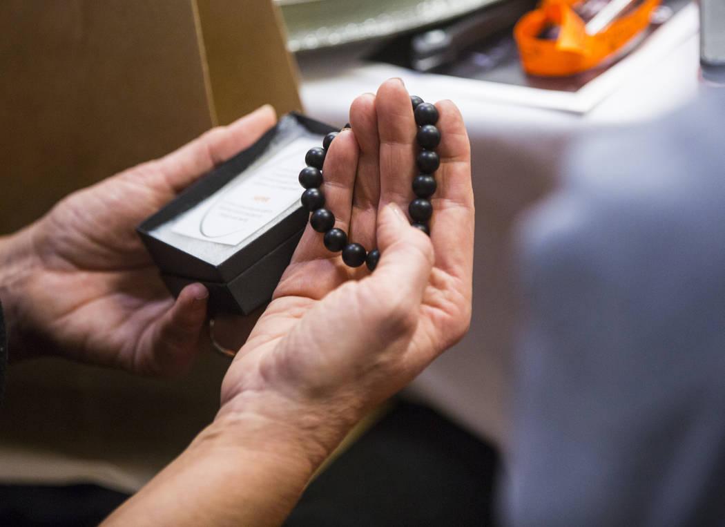 An Oct. 1 survivor holds an onyx bracelet given as a gift at Sunrise Hospital and Medical Center in Las Vegas on Friday, Sept. 14, 2018. (Chase Stevens Las Vegas Review-Journal @csstevensphoto)