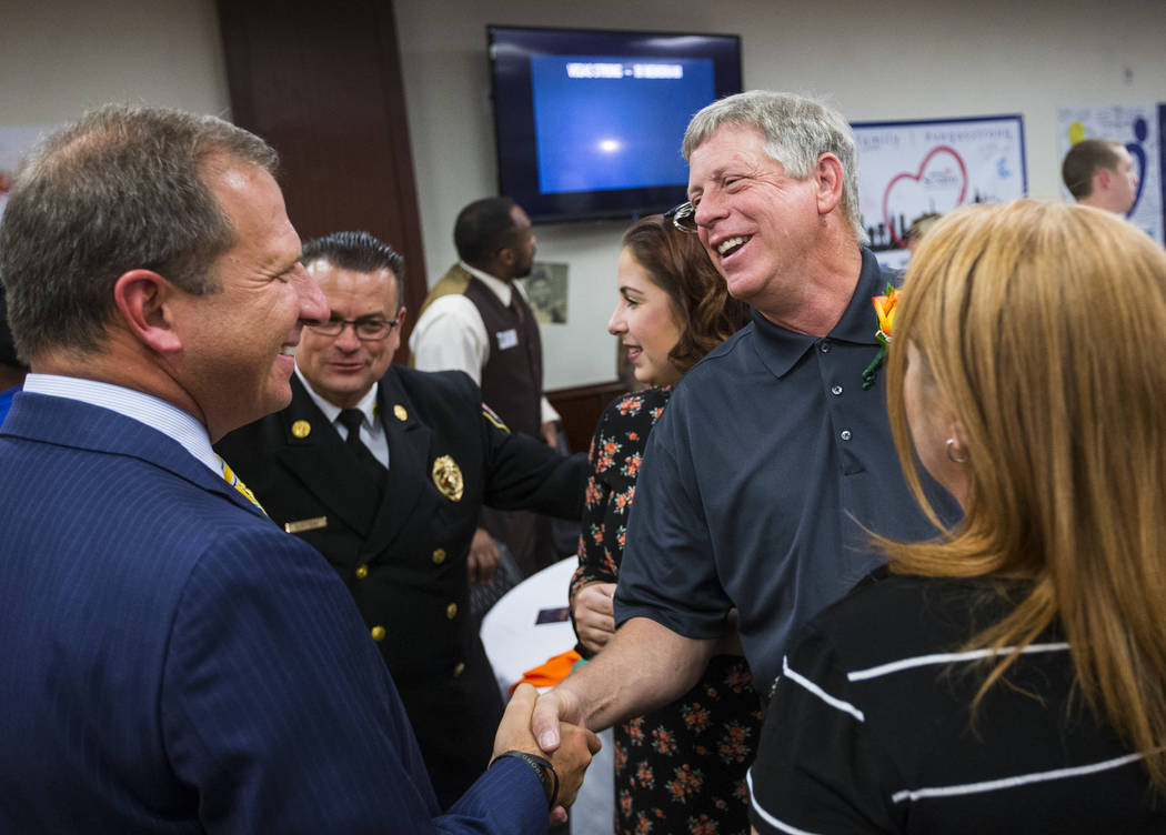 Sunrise Hospital CEO Todd Sklamberg, left, greets Steve Melanson, right, whose wife was shot and survived the Oct. 1 shooting, at Sunrise Hospital and Medical Center in Las Vegas on Friday, Sept. ...