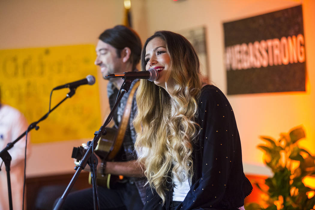 Cassandra and Jonathan Lawson of Ivy & the Wall peform during an event honoring the survivors of the Route 91 festival shooting and the caregivers and physicians that treated them at Sunrise H ...