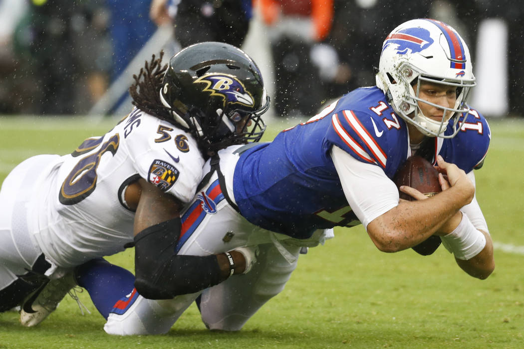 Buffalo Bills quarterback Josh Allen (17) is healed to the turf by Baltimore Ravens linebacker Tim Williams (56) during the second half of an NFL football game between the Baltimore Ravens and the ...