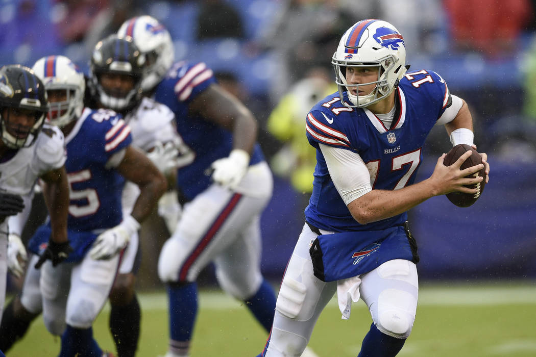 Buffalo Bills quarterback Josh Allen (17) scrambles with the ball during the second half of an NFL football game against the Baltimore Ravens, Sunday, Sept. 9, 2018, in Baltimore. (AP Photo/Nick Wass)