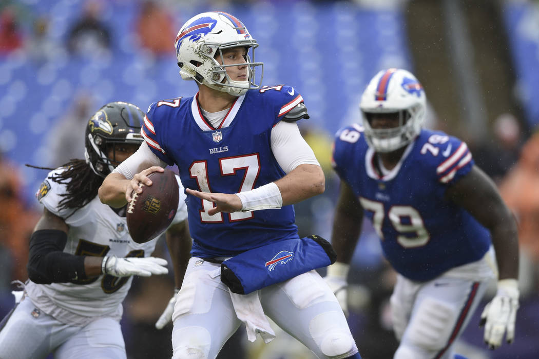 Buffalo Bills quarterback Josh Allen (17) looks for an open man during the second half of an NFL football game between the Baltimore Ravens and the Buffalo Bills, Sunday, Sept. 9, 2018, in Baltimo ...