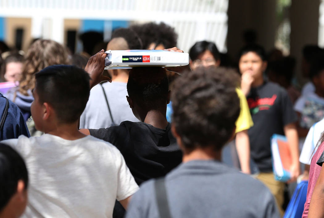 A student at Canarelli Middle School caries his binder as he leaves school on Friday, Aug. 24, 2018, in Las Vegas. (Bizuayehu Tesfaye/Las Vegas Review-Journal) @bizutesfaye