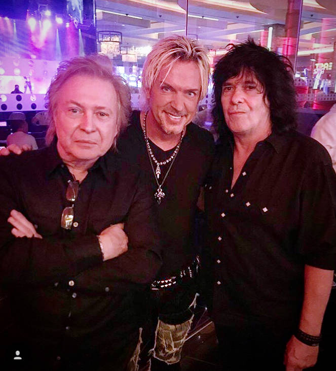 Chris Phillips is shown with Richard Cole, far left, and Mike Skill of The Romantics at 3rd Street Stage on Fremont Street on Saturday, Sept. 8, 2018. (Chris Phillips)