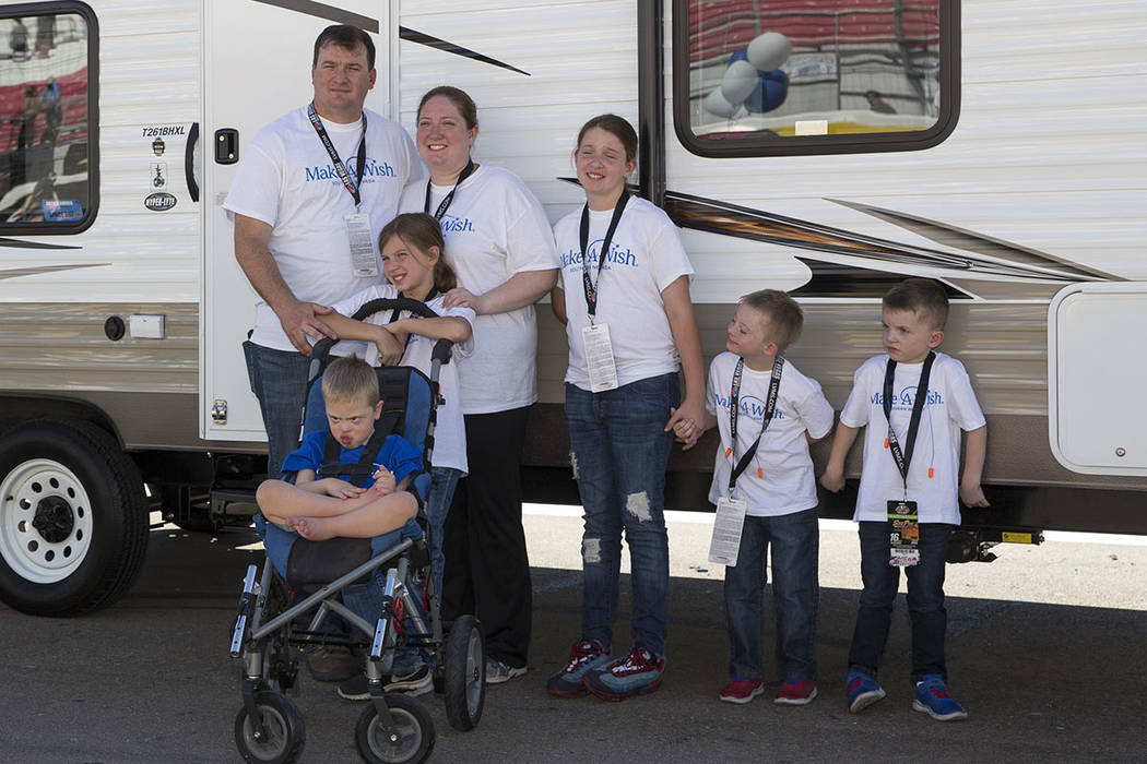Jared, left, and Tera Stacey, second from left, with their children including Andrew, 5, sitting in the wheelchair, pose outside their new travel trailer they received courtesy of the Make-A-Wish ...