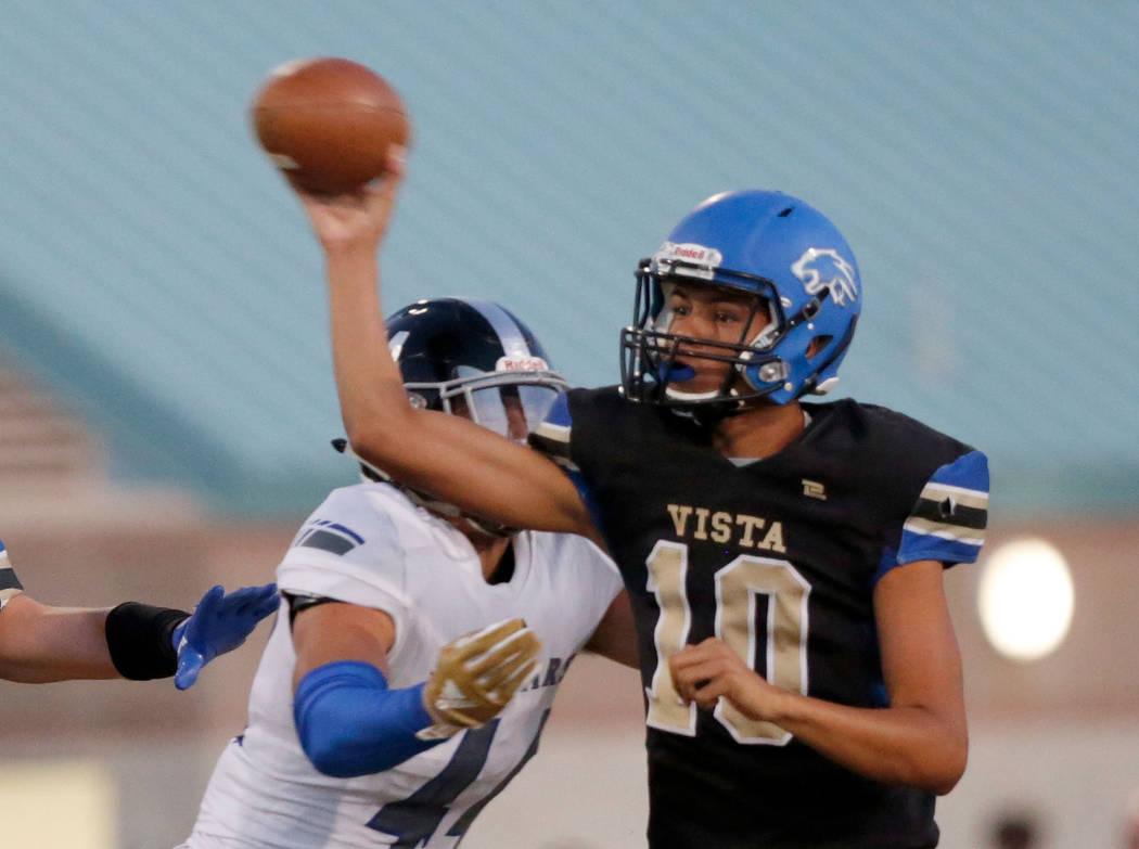 Sierra Vista's quarterback Jayden Maiava (10) throws against Desert Pines' Gabriel Lopez, left, during the first half of a football game at Sierra Vista High School in Las Vegas, Friday, Sept. 14, ...