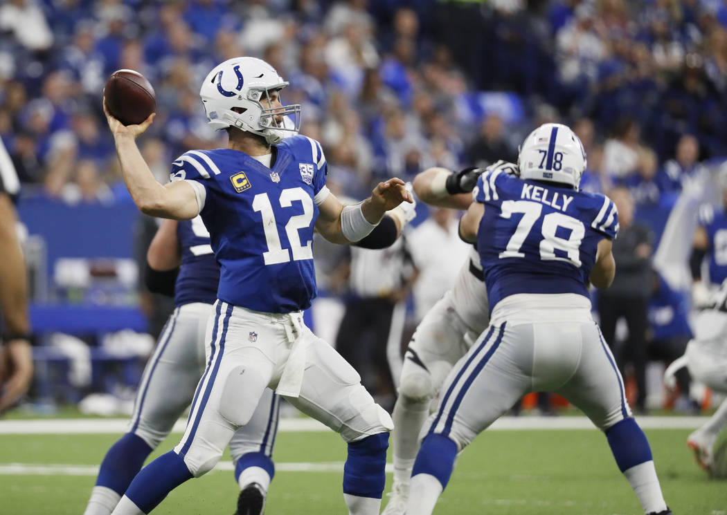 Indianapolis Colts quarterback Andrew Luck (12) throws against the Cincinnati Bengals during the second half of an NFL football game in Indianapolis, Sunday, Sept. 9, 2018. (AP Photo/John Minchillo)