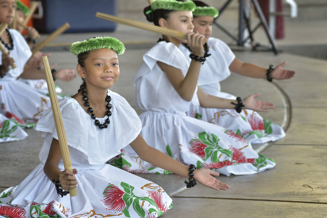 Zaydee Eras, 9, of Las Vegas, left, performs with Halau Hula 'O Kaleimomi during the 28th Annual Pacific Islander Festival and Ho'olaule'a at the Henderson Events Plaza at 200 S. Water St. in ...
