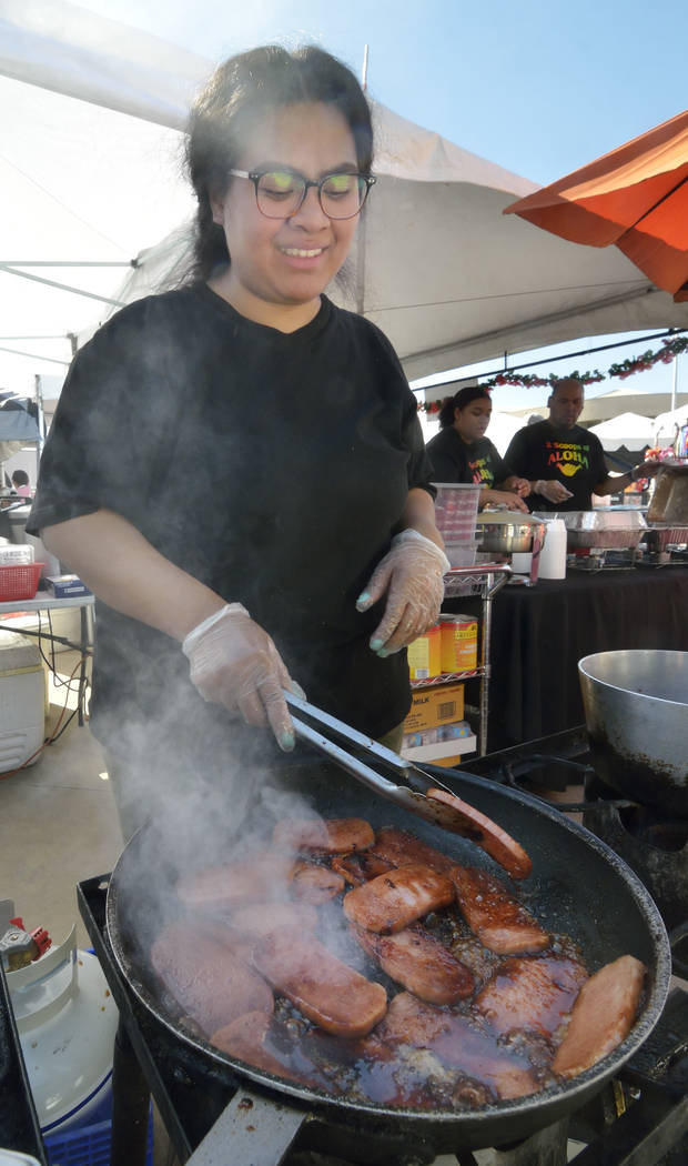 Me'A Roberts cooks spam at the Kama'aina Kravings booth during the 28th Annual Pacific Islander Festival and Ho'olaule'a at the Henderson Events Plaza at 200 S. Water S ...