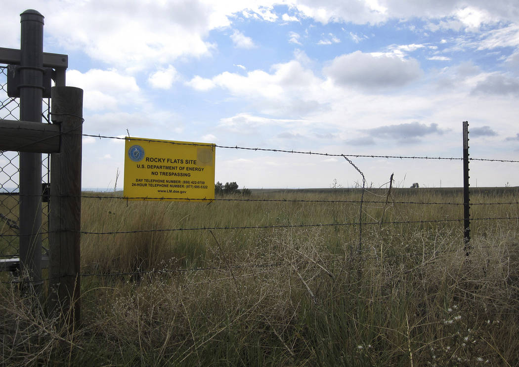 "A ""No Trespassing"" sign is seen hanging on a fence surrounding part of the former Rocky Flats nuclear weapons plant near Denver. (AP Photo/Dan Elliott, File)"