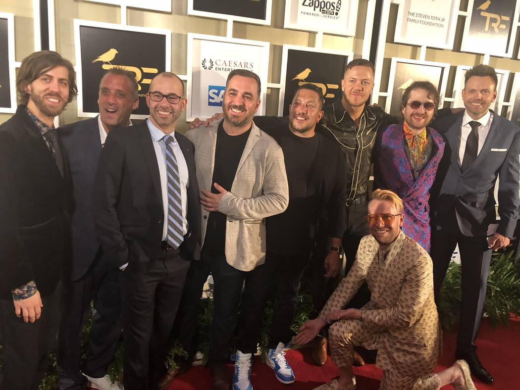 """The stars of truTV's """"Impractical Jokers"""" are shown with Imagine Dragons during the red-carpet walk at the Tyler Robinson Foundation Rise Up Gala at Caesars Palace on Friday, Sept. 14 2018. (John ..."""