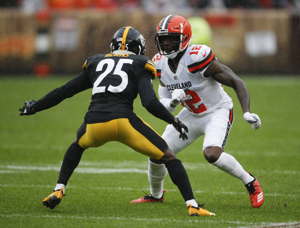 Cleveland Browns wide receiver Josh Gordon (12) plays against Pittsburgh Steelers cornerback Artie Burns (25) during the first half of an NFL football game, Sunday, Sept. 9, 2018, in Cleveland. (A ...