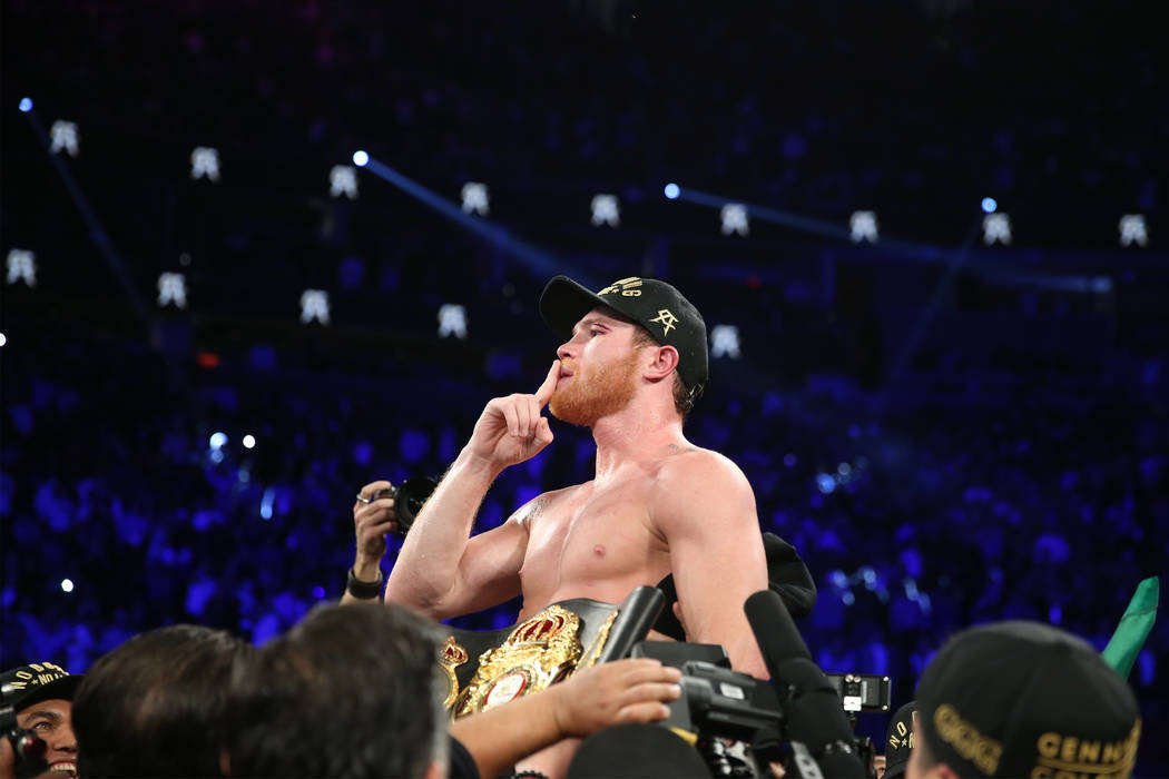 """Saul """"Canelo"""" Alvarez celebrates his split decision win against Gennady Golovkin in the WBC, WBA, IBO, RING middleweight title bout at T-Mobile Arena in Las Vegas, Saturday, Sept. 15, 20 ..."""