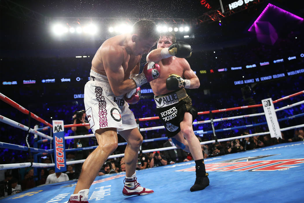 """Saul """"Canelo"""" Alvarez, right, throws a punch against Gennady Golovkin, in the WBC, WBA, IBO, RING middleweight title bout at T-Mobile Arena in Las Vegas, Saturday, Sept. 15, 2018.A ..."""